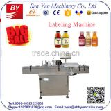Shanghai factory BY-TB100 automatic 50ml bottle labeling machine,sticker labeling machine for round bottles,bottle labeling