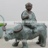 Longquan celadon ceramics creative ornaments household goods Cheung cattle Taurus bull riding cowboy statue and crafts for child