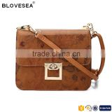 Classic shape in retro floral print with cross lock flap ladies small brown crossbody bag