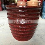 terracotta plant pots with red leopard glazed surface
