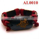 Tribe bracelet, Red cord bracelet braid with leather and ox bones carved with an insect pattern AL0010