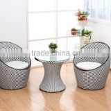 modernism rattan set tempered glass table two rattan egg chairs