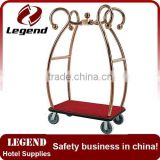 Used hotel luggage cart in bronze plated