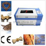 2015 hot selling wood arcylic leather portable 50w co2 laser engraving and cutting machine 6040