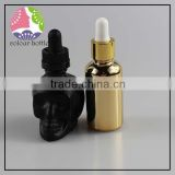 OEM manufacturer glass skull bottle with child proof dropper tamper ring 30ml 60ml 120ml for e liquid