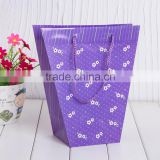 China Manufacture eco friendly customize Printing PP plastic flower carry bags with hanging for potted plant and flower