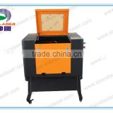 Low Price multi-function Crystal,Wood, MDF, Glass, Crystal, Marble, Stone Laser engraving machine with Rotary device