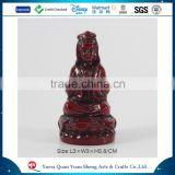 Custom statue brick-red budda statue