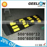 yellow and black parking vehicle rubber speed bump