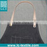 black denim apron with leather straps