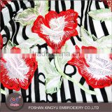 Hot-selling promotional custom crystal yarn red flower black stripe swiss lace for evening party dress use lace fabric