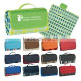 "Roll-Up Picnic Blanket - measures 52"" x 47"", made from polyester fleece plaid with lining and water-resistant PE backing"