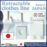 metal wire clothes hanger made in Japan to dry clothes indoor with retractable wire and sophisticated design