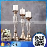 China supply different highly home decoration resin candle holder sets silvery carved candlesticks