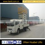 Factory price motorized hydraulic vehicular lift table scissors type aerial work platform