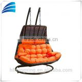 Indoor outdoor patio resin wicker brown handweave two seat swing chair with orange cushion