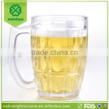 Machine made clear glass beer mug with handle
