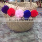 Eco-friendly Hottest selling natural seagrass belly basket with multi-color pompoms by vietnamese