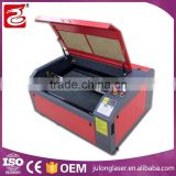 low price high speed co2 laser cutter jigsaw puzzle laser cutting machine for small business