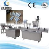 automatic glass bottle/plastic bottle spray filling and capping machine.Nasal drops spray filling machine
