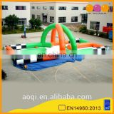 AOQI commercial use inflatable interactive race track sports game for sale