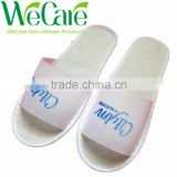 Cheap disposable non woven indoor hotel slippers with logo printed