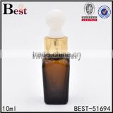 10ml round shoulder pharmaceutical amber glass serum bottle with gold color dropper                                                                                                         Supplier's Choice
