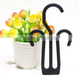 black plastic shoe hook
