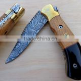 "udk f59"" custom handmade Damascus folding knife / pocket knife with buffalo horn and walnut wood and bras booster handel"