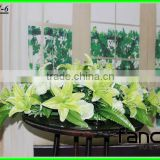 latest cream lily flower indian wedding reception table boat decorations