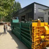 four Automatic packing of waste paper shell baler