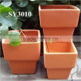 Small square terracotta planter pots
