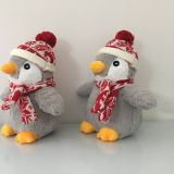 Plush toy penguin with hat scarf