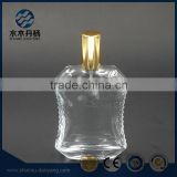 Fancy 50ml unique shaped perfume glass bottle with golden spray                                                                                                         Supplier's Choice