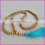 NE2166 Wooden bead Mala necklace with turquoise stone beads and a pale turquoise tassel