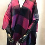 acrylic woven poncho with classic check design