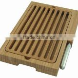 Bamboo bread cutting board with knife