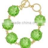 Gold Tone Peridot Glass Toggle Bracelet