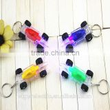 China LED Manufacturer Custom LED Keychain Plastic LED Toy Car Key Chain In Custom Colors