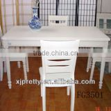 white wooden dining table with chairs