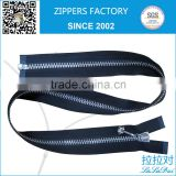 exposed metal zipper black tape with silver teeth and regular pull