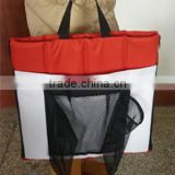 Folded red stadium seat cushion for outdoor sports