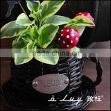 cup and saucer shaped black willow flower basket