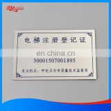 Chemically etched stainless steel nameplate for machine