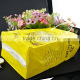 shopping plastic handle bag , yellow printing square bottom side gusset plastic bag with paper card