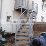outdoor helical stairs with wood steps and metail railing