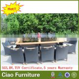 Luxury outdoor extended glass dining table and teakwood chairs