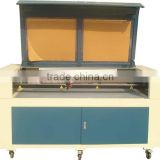 hot sale automatic co2 laser tube paper roll and fabric cutting machine price with DW1610 model