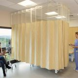 Inherent flame resistant polyester medical curtain fabric with mesh