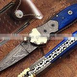 A CAMEL COLORED BLUE BONE HANDLE HANDMADE DAMASCUS STEEL POCKET FOLDING KNIFE.